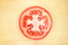 Sliced tomato on wooden cutting board Stock Photography