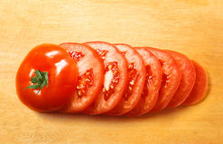 Sliced tomato on wooden plate Royalty Free Stock Photo