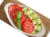 Sliced tomatoes anmd zucchini in dish Stock Photos