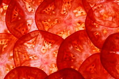 Sliced tomatoes as food background, top view Stock Image