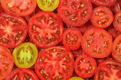 Sliced tomatoes background. Royalty Free Stock Photo