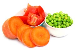 Sliced tomatoes, carrot and green peas Royalty Free Stock Image