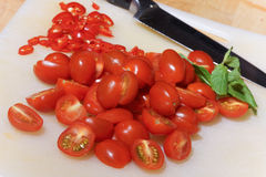 Sliced tomatoes and chili Royalty Free Stock Photos
