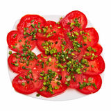 Sliced tomatoes with chive on top. Royalty Free Stock Photos