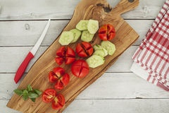 Sliced tomatoes on chopping board Stock Image