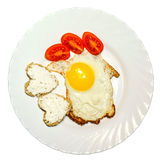 Sliced tomatoes, fried eggs and toast in the shape of heart on a plate top isolated Stock Photos