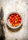 Sliced tomatoes in a metal Cup. Royalty Free Stock Photography