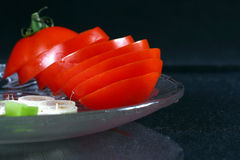 Sliced tomatoes and onions Royalty Free Stock Image