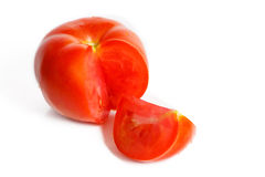 Sliced tomatoes on a white background Royalty Free Stock Photos