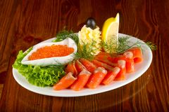 Sliced trout and red caviar. Served lemon royalty free stock photography