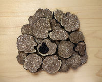 Sliced truffles on wooden board Royalty Free Stock Image