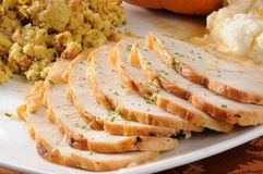 Sliced turkey. A serving platter with sliced turkey breast with mashed potatoes and stuffing stock photos