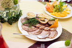 Sliced turkey with aromatic herbs royalty free stock photos