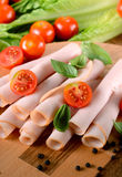 Sliced turkey breast. Appetizer of sliced turkey breast rolled up on the cutting board royalty free stock photo