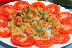 Sliced turkey. With rice and tomatoes on a plate stock images
