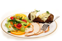 Sliced turkey and salad meal side view Royalty Free Stock Photo
