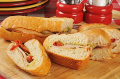 Sliced turkey sandwich. A sliced turkey and avocado sandwich with basil pesto stock image