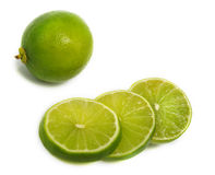 Sliced and unsliced lime Stock Photo