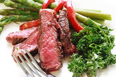 Sliced up steak with asparagus Royalty Free Stock Photo