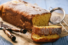 Sliced vanilla pound cake on wooden background. Selective focus. Royalty Free Stock Images