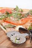 SLICED VEGAN PIZZA TOMATO ROUND BOARD Royalty Free Stock Photo
