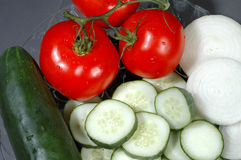 Sliced vegetables. Sliced onions, sliced cucumbers, tomato Royalty Free Stock Photos