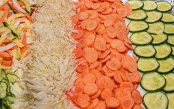 Sliced vegetables. Cucumber, carrot, cabbage cutting into circles Royalty Free Stock Image