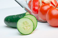 Sliced vegetables cucumbers tomatoes peppers Stock Photos