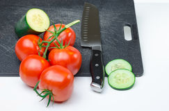 Sliced vegetables on Cutting Board. Green and red vegetables sliced on black cutting board Stock Photography