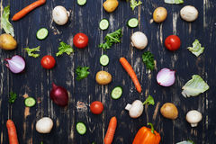 Sliced vegetables evenly arranged over wooden flat layout. Top view of vegetables evenly arranged over wooden flat layout. Assortment of fresh vegetables. Fresh Royalty Free Stock Photography