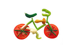 Sliced vegetables in form of a bicycle. Different sliced vegetables in form of a bicycle Royalty Free Stock Photography