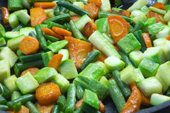 Sliced vegetables, fried in butter in a frying pan Royalty Free Stock Image