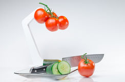 Sliced vegetables on Glass Plate and hook white background Royalty Free Stock Photography
