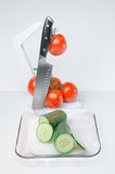 Sliced vegetables on Glass Plate and hook white background Stock Image