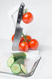 Sliced vegetables on Glass Plate and hook white background Stock Images