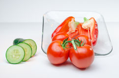 Sliced vegetables on Glass Plate white background Royalty Free Stock Photography