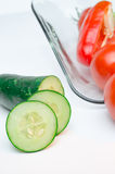 Sliced vegetables on Glass Plate white background Royalty Free Stock Images