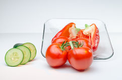 Sliced vegetables on Glass Plate white background Royalty Free Stock Photos