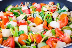 Sliced vegetables in the pan Stock Image