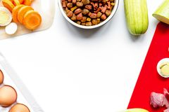Sliced vegetables and petfood on kitchen table background top vi stock images