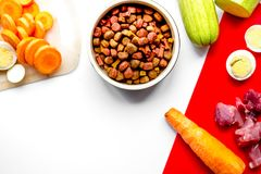 Sliced vegetables and petfood on kitchen table background top vi stock image