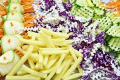 Sliced vegetables for salad. Potatoes carrot cabbage Royalty Free Stock Photography