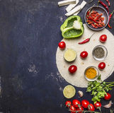 Sliced vegetables on tortilla, Ingredients for cooking burritos border with text area on wooden rustic background top view  vertic Royalty Free Stock Photos