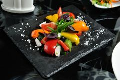 Sliced vegetables on a wooden board in a restaurant, cucumbers, Royalty Free Stock Photo
