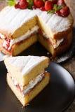 Sliced Victoria sandwich cake closeup on a plate. vertical Stock Photo