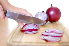Sliced violet onion on cutting board Stock Photos