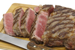 Sliced wagyu steak. View of a partly-sliced grilled wagyu beef ribeye steak viewed from above Stock Image