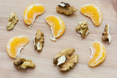 Sliced walnuts and mandarin oranges Stock Image