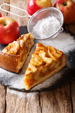 Sliced warm apple pie close-up on a table and fresh juice. verti. Sliced warm apple pie close-up on a table and fresh apple juice. vertical Stock Image