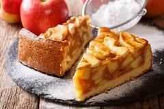 Sliced warm apple pie macro on a table. Horizontal. Sliced warm apple pie close-up on a table. Horizontal Stock Photography